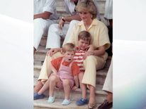 Aug 1987: Diana holds William, 6, and Harry, 3, as they pose during the mornings's picture session in Palma de Mallorca, Spain