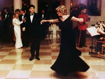 Nov 1985: Diana wears a Victor Edelstein gown as she dances at a White House dinner with John Travolta. The gown sold for $222,500 during an AIDS charity auction