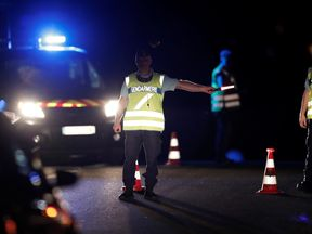 French gendarmes maintain a roadblock after a car ploughed into the terrace of a pizzeria, killing a young girl and injuring several other people according to media reports in Sept-Sorts, east of Paris