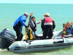 A family impacted by the fire enjoy a speeboat ride in West Sussex