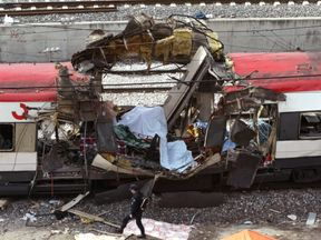 A hole blasted through a train at Madrid's Atocha station - one of ten explosions that killed 193 people in 2004