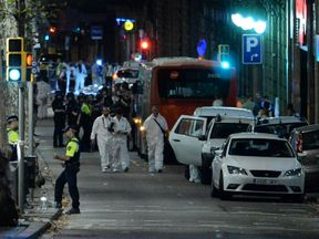 Forensic police arrive at a cordoned area after a van struck people in Barcelona