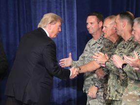 Trump meets troops