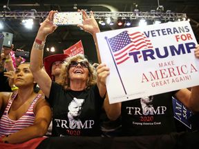 Donald Trump supporters cheer him at a campaign rally in Phoenix