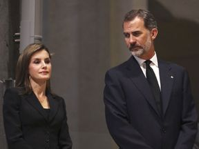 Spain's King Felipe VI and Spain's Queen Letizia attend a mass