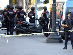 Armed police stand guard after the Barcelona attack