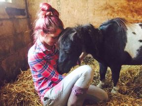 """BEST QUALITY AVAILABLE Undated handout photo issued by Khrystinea Farnworth of herself with Matilda the rescue Shetland pony who was savagely stabbed in the neck and has had """"her trust broken by a human again"""", her heartbroken owner has said. PRESS ASSOCIATION Photo. Issue date: Monday August 21, 2017. Matilda is recovering after being attacked in a field near Preston, Lancashire, but her son, Lucas, suffered similar wounds and did not survive."""