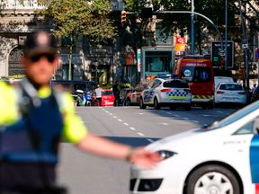 A policeman blocks a street following the attack in Barcelona