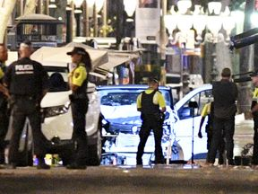 A damaged van, believed to be the one used in the attack on Las Ramblas