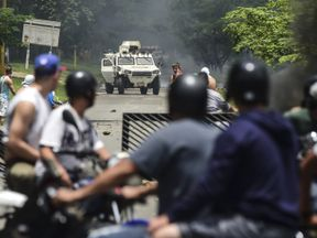 Anti-government activists and the National Guard clash in Venezuela's third city, Valencia