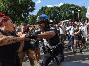 KeithHEADLINE:Counter protesters clash with Boston Police outside of the Boston Commons and the Boston Free Speech...