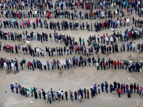 People queue to cast their vote outside a polling station in the city centre in Nairobi