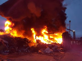 Photographs from the scene show intense flames at the site. Pic: @Blackburn_fire