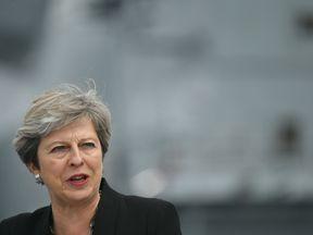 Theresa May on the flight deck as she speaks to crew members of HMS Queen Elizabeth