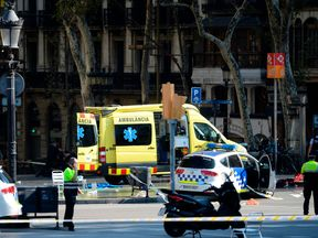 Police and an ambulance at the scene of the Barcelona attack