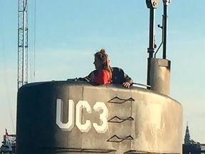 This photo shows allegedly Swedish journalist Kim Wall standing in the tower of the private submarine 'UC3 Nautilus' on August 10, 2017 in Copenhagen Harbor