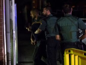 One of the four suspects is escorted in Madrid
