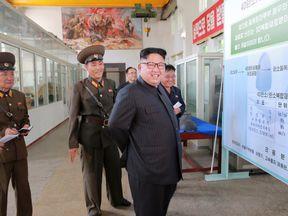 Kim Jong Un inspects work at a North Korean munitions factory