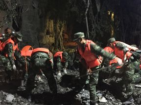 Chinese paramilitary police search for survivors after an earthquake in Sichuan province