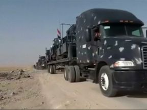 Military vehicles descend on Tal Afar