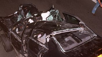 The back of the crumpled wreck of the Mercedez-Benz