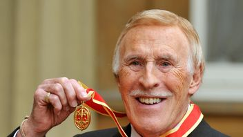 Sir Bruce after he was knighted by the Queen in 2011