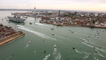 A flotilla of small boars surrounded the ship as it entered the harbour. Pic: MoD