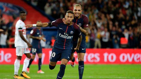 Neymar celebrates after scoring one of two goals on his Paris St Germain debut