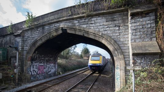 BATH, ENGLAND - FEBRUARY 19: A London Paddington bound train approaches Bath Spa station on the Great Western railway line on February 19, 2016 in Bath, England. The electrification of the route and the replacement of the ageing diesel powered rolling stock, some of which dates back to the nationalised British Rail era of the 1970s, was meant to have been completed by 2016.