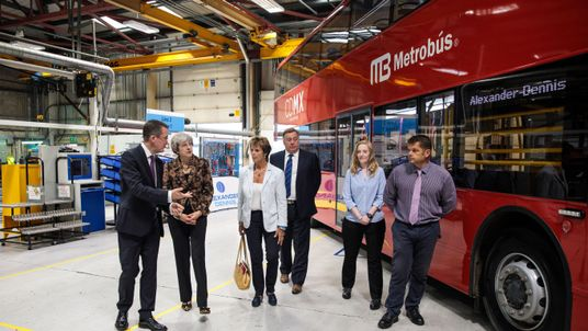 Theresa May tours the Alexander Dennis bus and coach manufacturers factory in Guildford