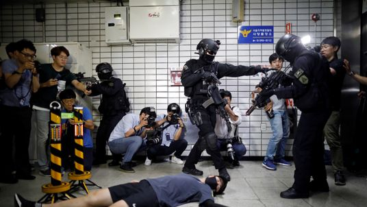 Members of SWAT take part in an anti-terror drill as part of the Ulchi Freedom Guardian exercise in Seoul...