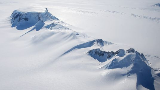 Mountains on the West Antarctic Ice Sheet are viewed from a NASA plane in 2016