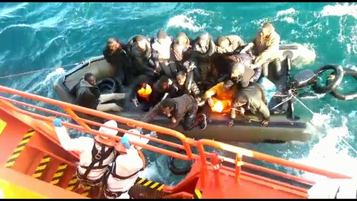 Spanish coastguard rescues migrants from a dinghy