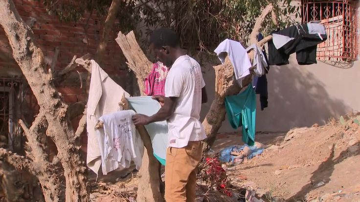 Would-be migrants hang their washing on trees in Tangier, Morocco