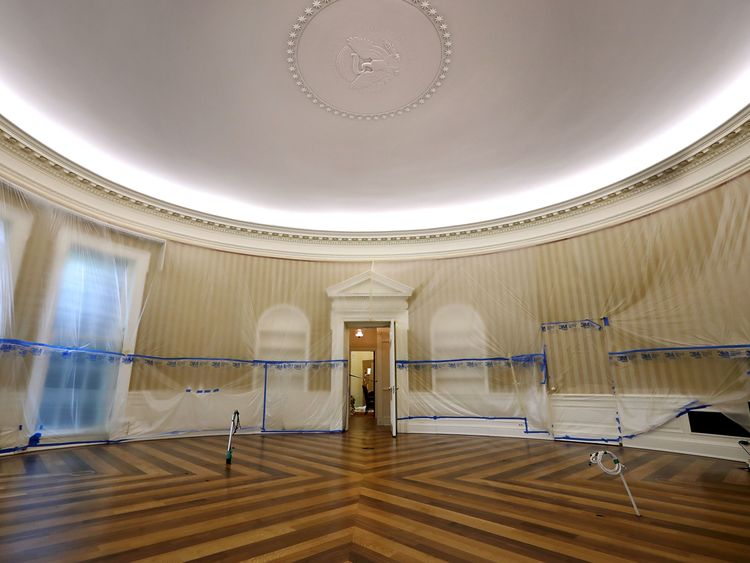 WASHINGTON DC- AUGUST 11 The Oval Office sits empty and the walls covered with plastic sheeting during renovation work at the White House