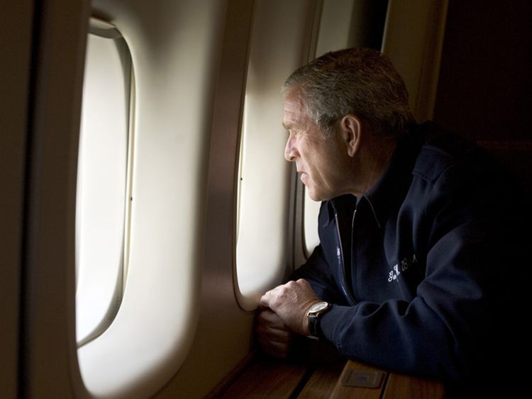George W. Bush looks out over devastation from Hurricane Katrina