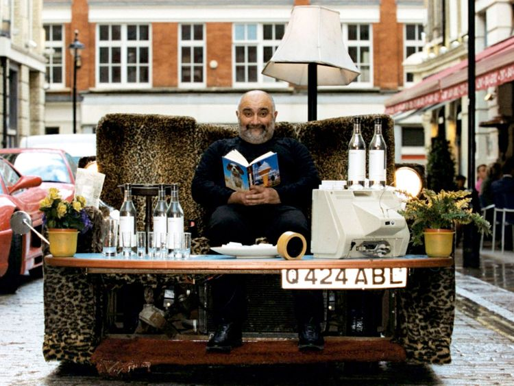 Writer and comedian Alexei Sayle reads from his new book The Dog Catcher on a motorised sofa outside MOMO in London