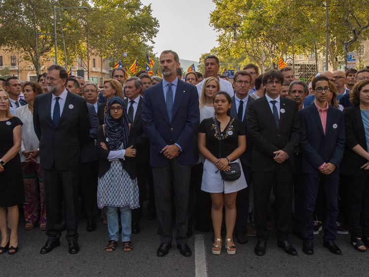 King Felipe VI of Spain (centre) was at the head of the march