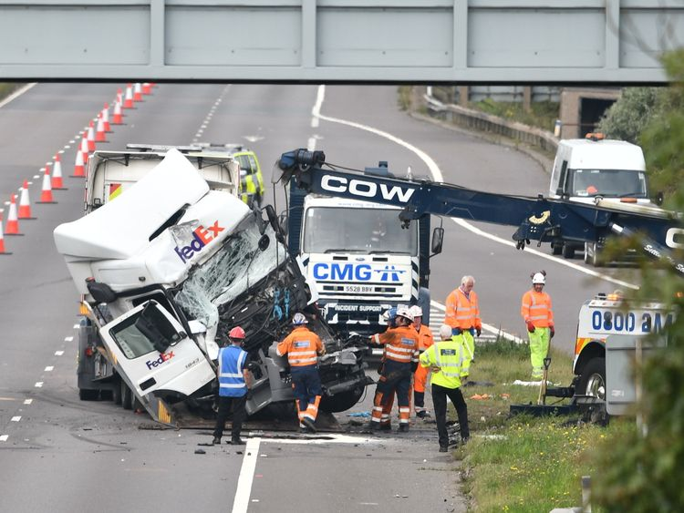 One of the lorries involved in the fatal M1 crash is removed from the carriageway