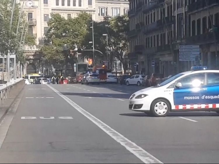 A police car blocks the road after the collision