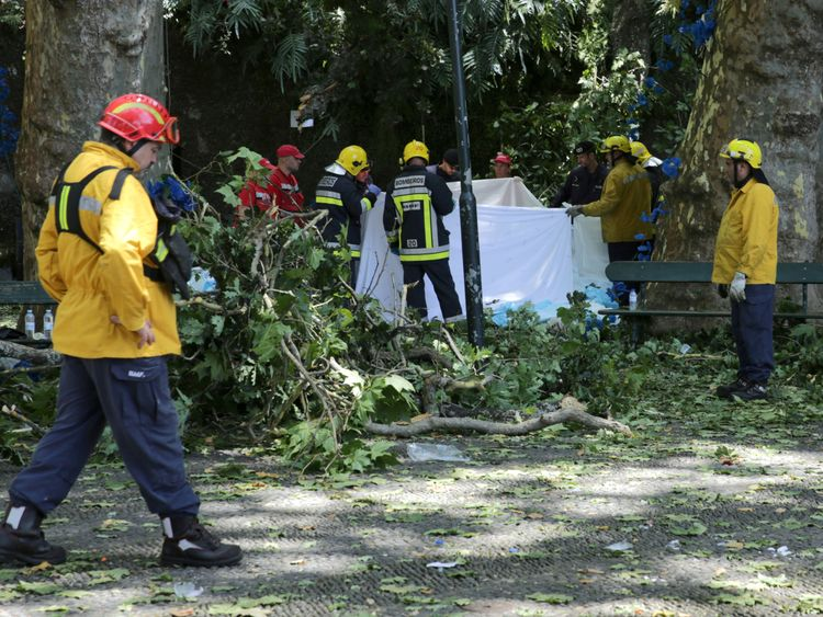 Rescue workers recover a victim's body