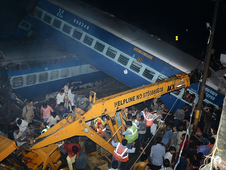 Emergency workers look for survivors on the wreckage of a train carriage after an express train derailed near the town of Khatauli in the Indian state of Uttar Pradesh on August 19, 2017
