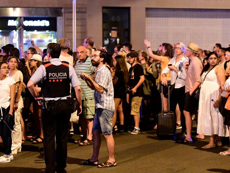 Tourists wait to be allowed back to their hotels