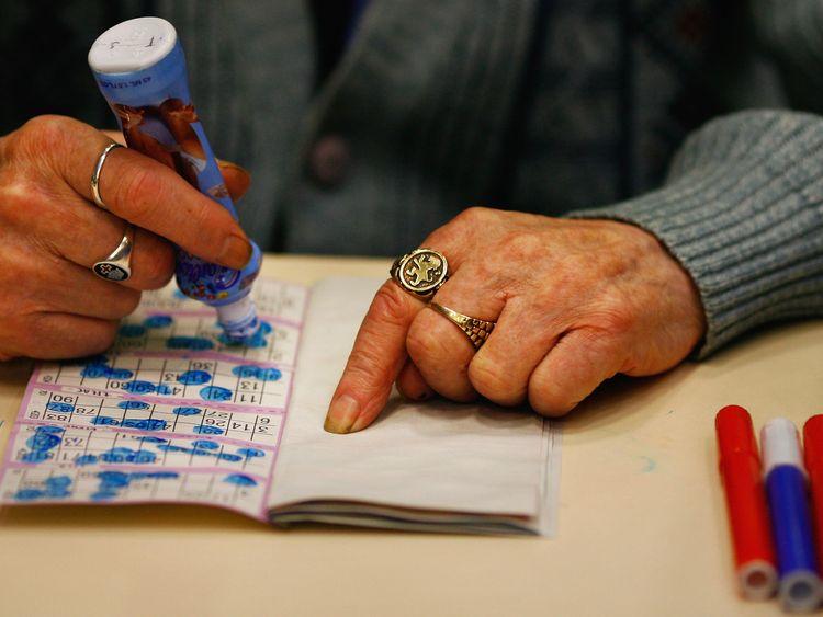Woman plays bingo in Glasgow, Scotland