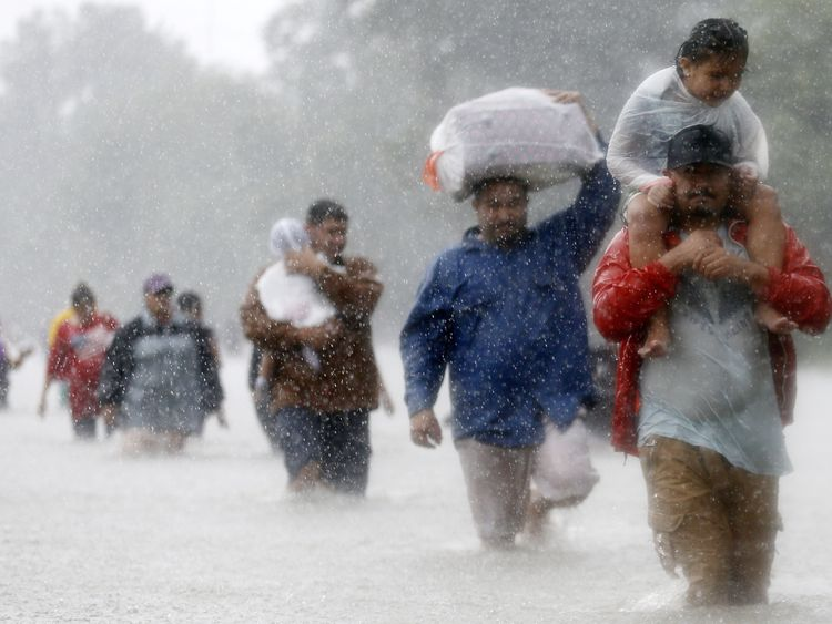 Texans wade through flood waters in Beaumont Place