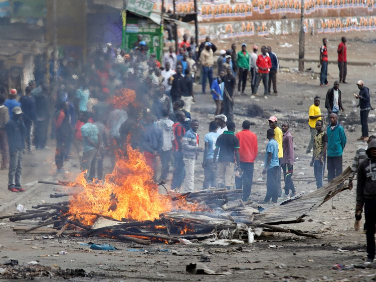 A barricade is set on fire in Mathare, Nairobi, during the protests
