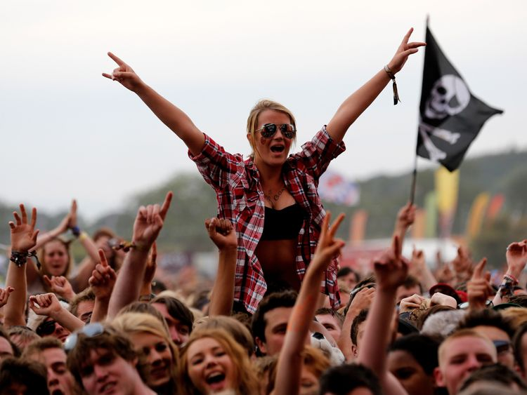 READING, ENGLAND - AUGUST 26: A fan soaks up the atmopshere as the Kaiser Chiefs performs live on the Main Stage on Day Three during the Reading Festival 2012 at Richfield Avenue on August 26, 2012 in Reading, England. (Photo by Simone Joyner/Getty Images)