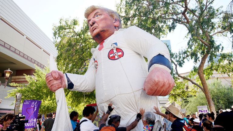 Pro-Trump supporters face off with peace activists during protests outside a Donald Trump campaign rally in Phoenix, Arizona, U.S. August 22, 2017