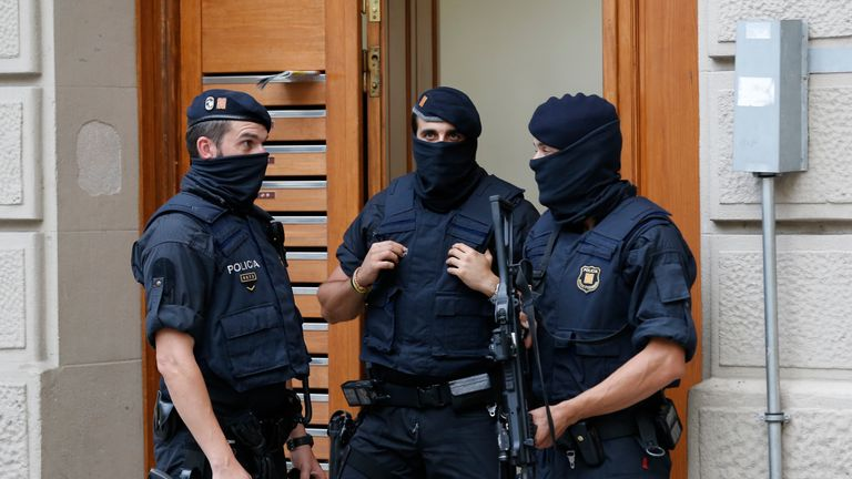 Police officers outside a house in Ripoll during a search linked to the Barcelona attack