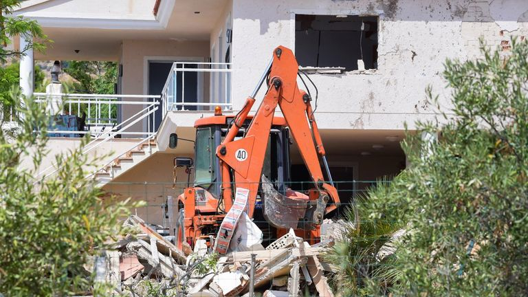 The rubble of a house where suspects of this week's twin assaults in Spain